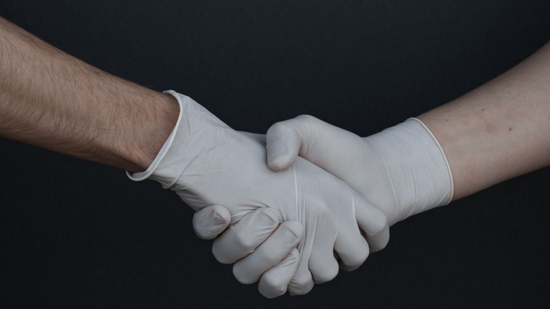 shaking hands with gloves